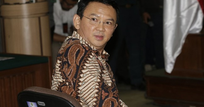 Governor of Indonesia capital sobs as blasphemy trial begins