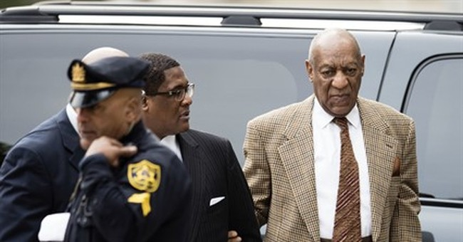 The Latest: Prosecutors ask to put Cosby accusers on stand