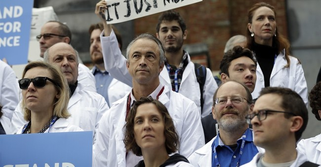Lab coats vs. climate change: Scientists rally for research