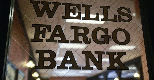 Feds slap curbs on Wells Fargo, find 'living will' lacking