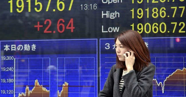 Global stocks mixed ahead of Fed's rate decision