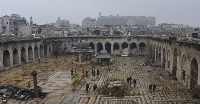 Rebels to evacuate Aleppo in surrender deal as fighting ends