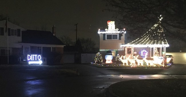 With 'Ditto' in lights, family concedes to next-door display