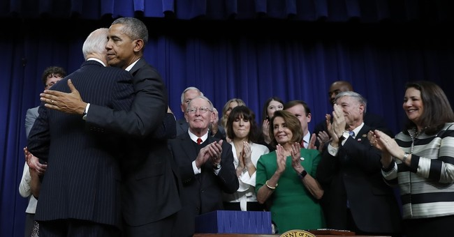 Obama signs bill boosting spending on cancer research