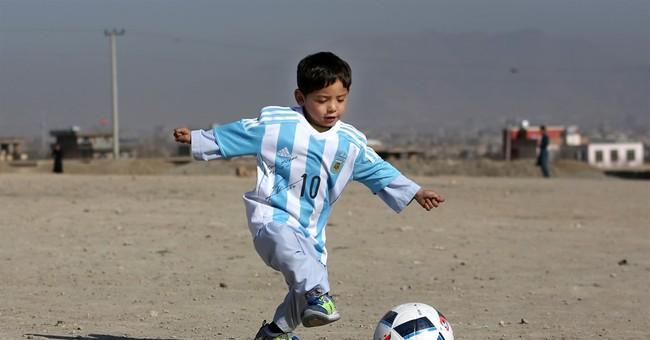 'It's a dream': Afghan boy finally meets idol Lionel Messi