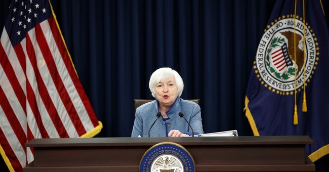 The Latest: Stocks ending lower after Fed rate hike