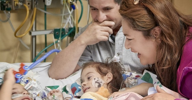 Separated conjoined twins meet for first time since surgery