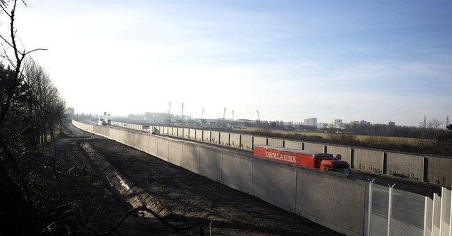 Migrants are gone yet Calais builds new wall near highway