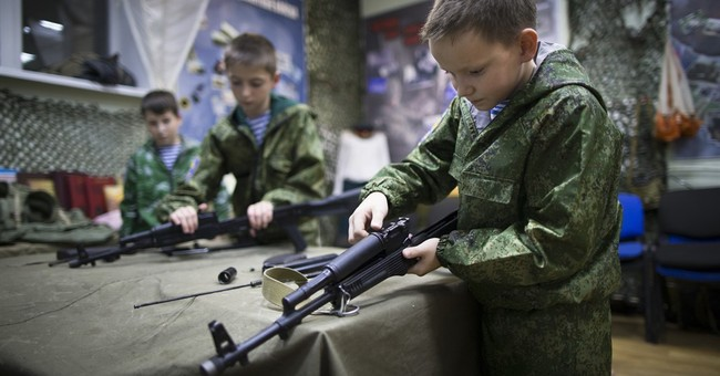 AP PHOTOS: Russian youths learn basic military skills