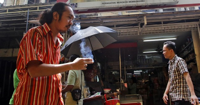 Philip Morris Int'l results mixed, outlook disappoints