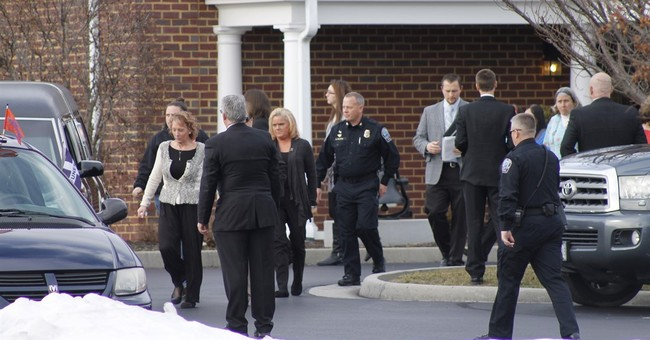 The Latest: Hundreds mourn slain 13-year-old at funeral