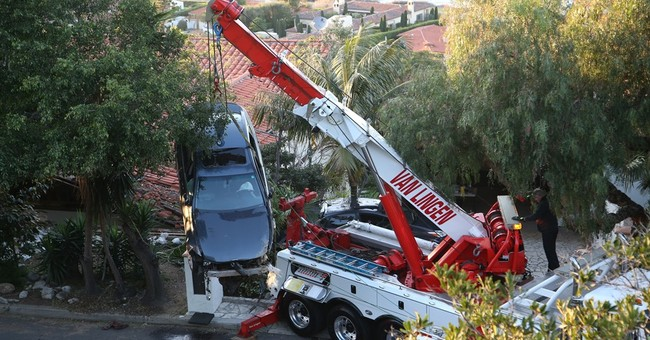 Careening car ends up on roof of Southern California house
