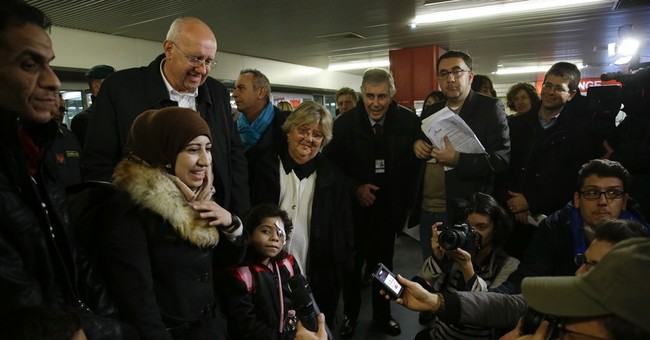 Syrian family arrives in Italy in first humanitarian airlift