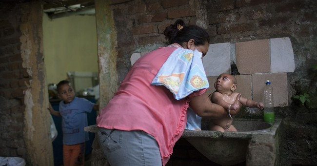 AP photographer reflects on 'bucket baby' in Brazil
