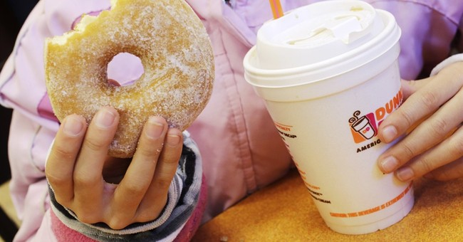 Dunkin's preps for a deal fight as customer visits slip