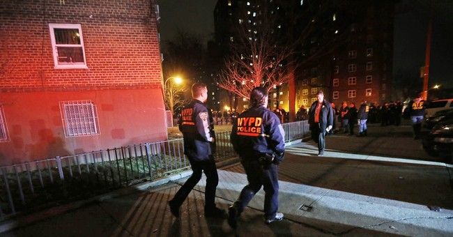 2 police officers shot in New York public housing complex
