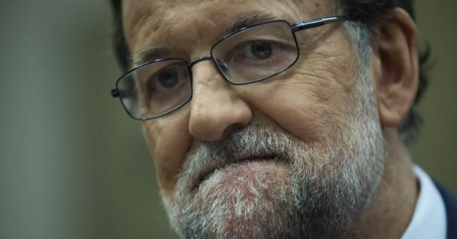 Spanish king's UK trip delayed amid talks to form gov't