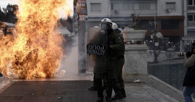 Protests, EU demands add pressure on Greece's Tsipras
