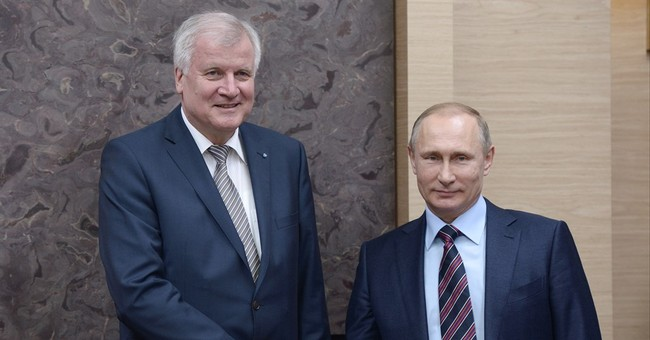 German state governor draws criticism over Putin visit