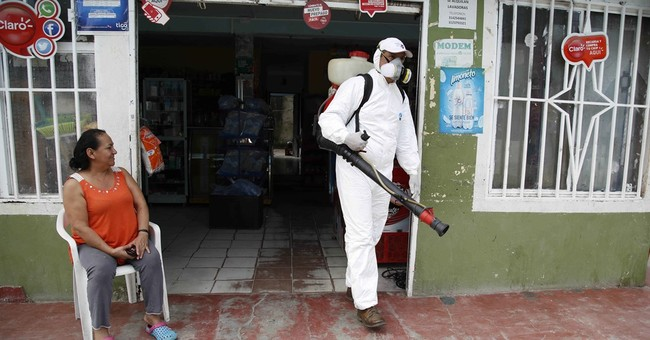 The Latest:  US, Colombia to team up on Zika research