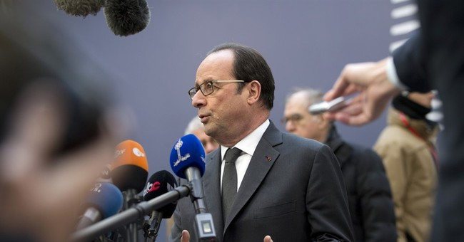 France puts weight behind Greece in debt dispute