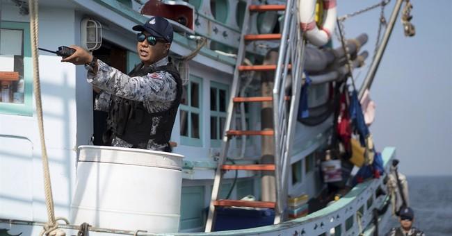 Greenpeace: Thai fishing boats sail far to avoid regulations