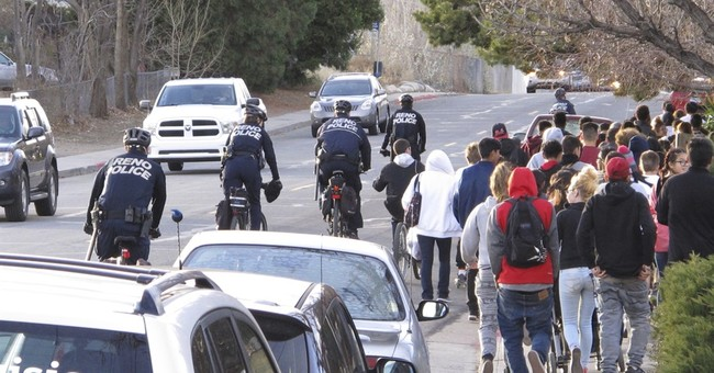 100 march to protest school police shooting of Reno teen
