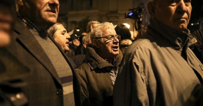 Greek lawmakers approve pension bonus that angered creditors