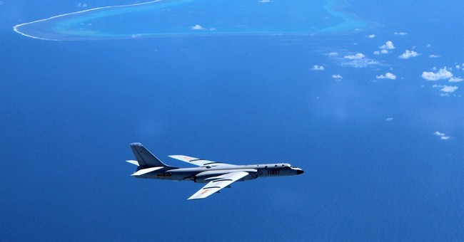 Report: Beijing adds weapons to South China Sea islands