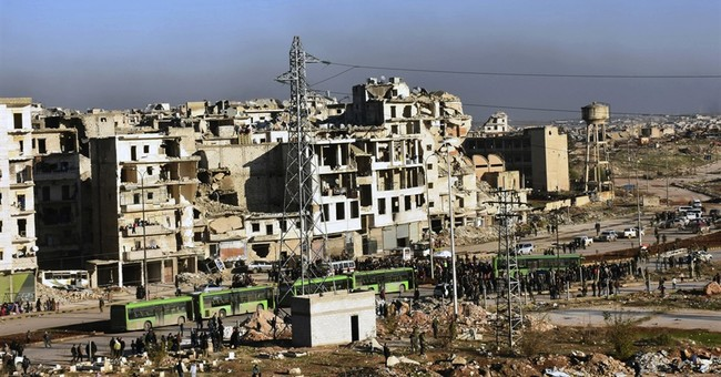 Bloodied and demoralized Syrians evacuate Aleppo