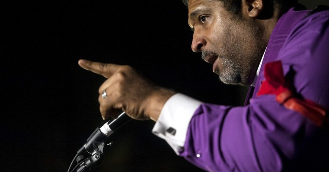 N. Carolina NAACP leader sues over being removed from flight