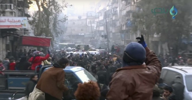 The Latest: Syrian opposition group supports call for talks