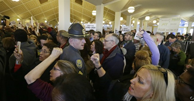 The Latest: Lawmakers adjourn session curbing gov's powers