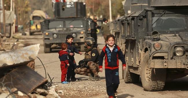 Iraq: retaken Mosul towns still battle-stricken, await aid