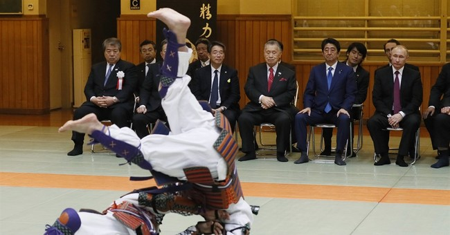 The Latest: Putin visits judo center in downtown Tokyo