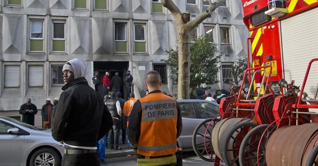 1 dead, several hurt in fire at migrant center near Paris