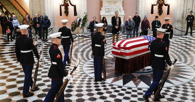 The Latest: John Kerry joins mourners at John Glenn viewing