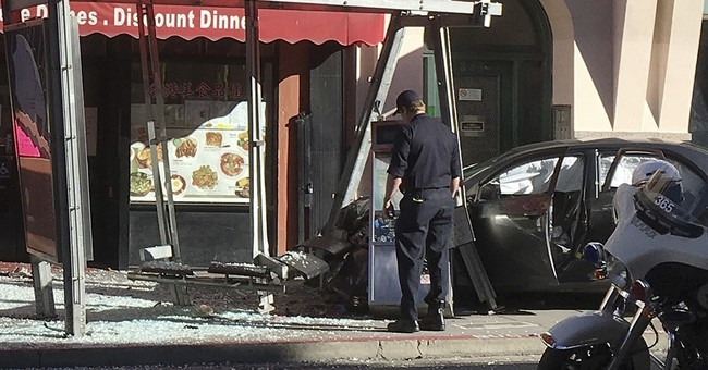 Car rams bus stop in San Francisco's Chinatown, 10 hurt