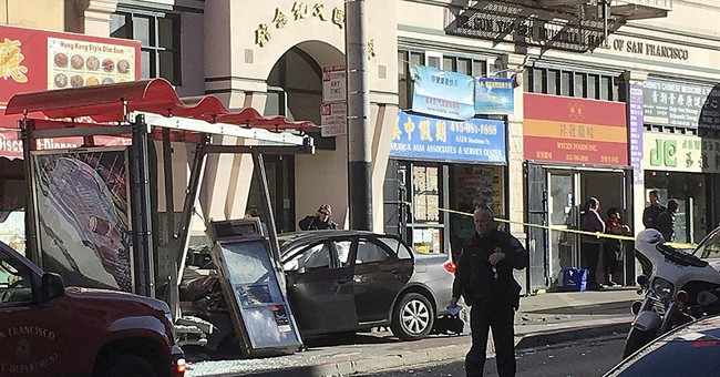 Car rams bus stop in San Francisco's Chinatown, 10 hurt