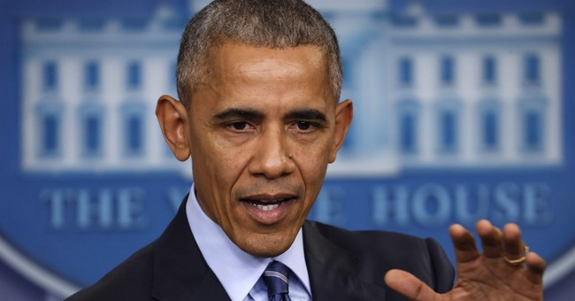 Obama, rapping Putin, says US could strike back on cyber
