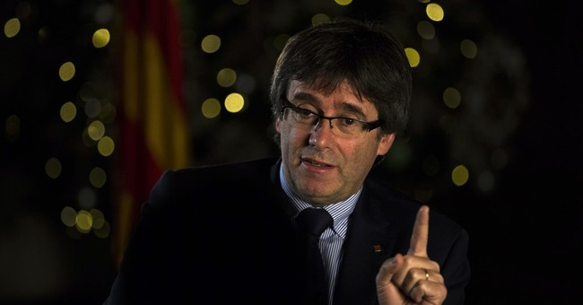 Catalan leader mulls early vote on break with Spain