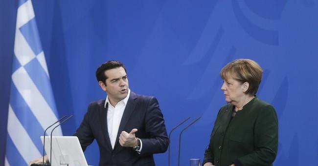 Greece's Tsipras visits Germany amid argument over bonus