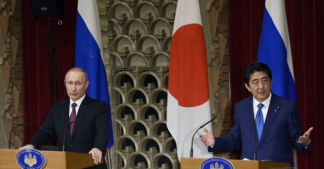 Japan, Russia agree on economic ties; stalemate on territory