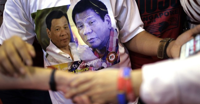 Duterte says he'll set aside sea feud ruling against China