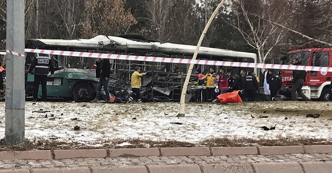 Car bomb kills 13 Turkish soldiers on bus; 7 suspects held