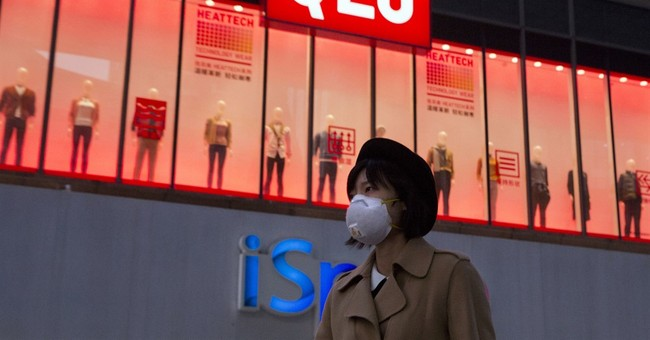 China restricts cars, factories amid latest smog alert