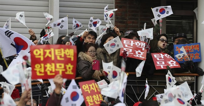 Supporters of impeached SKorean leader clash with protesters