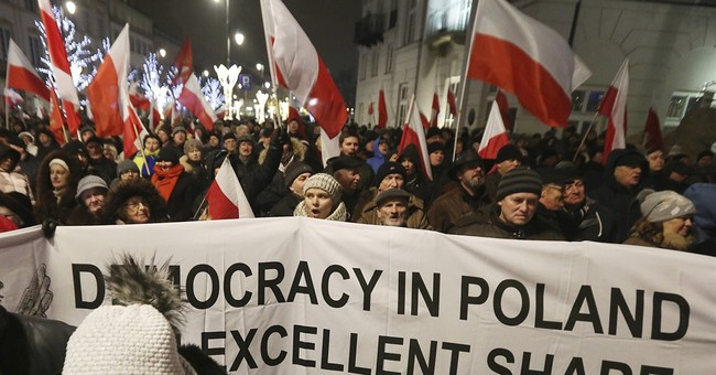 Poland's president talks with opposition, protests spread