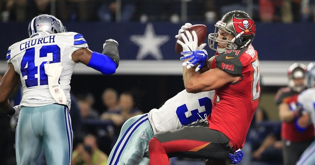 Red-letter day: Elliott, Cowboys bounce back, top Bucs 26-20