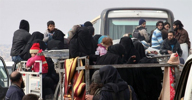 The Latest: 1st Aleppo evacuees in 2 days reported